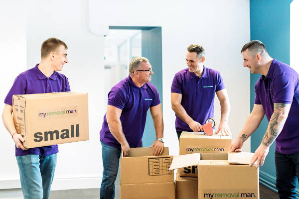 picture of four specialist and piano movers during packing