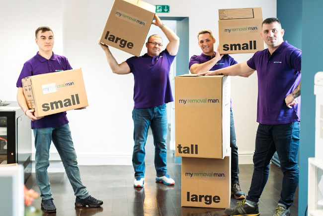 picture of four house removals company staff carrying boxes